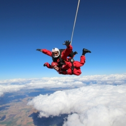 LUCIE ABOVE THE CLOUDS ON HER CHARITY SKYDIVE FOR RADIO CITY CASH FOR KIDS