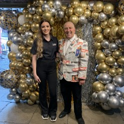 Gold chrome and Silver chrome balloon backdrop with Gold and Silver foil.  Disco theme with Pete Price