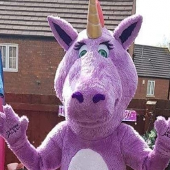 STAR THE UNICORN AT A GARDEN PARTY IN THE SUMMER