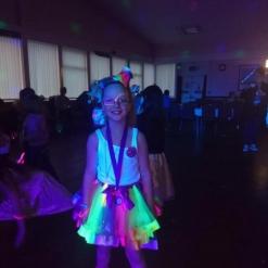 UV GLOW DISCO CHILD POSING IN NEON CLOTHES