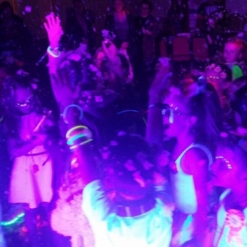 UV GLOW DISCO KIDS DANCING IN NEON AND WHITE CLOTHES ADDING TO THE GLOW