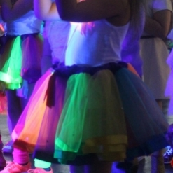 UV GLOW DISCO CLOSE UP OF NEON DRESS GLOWING