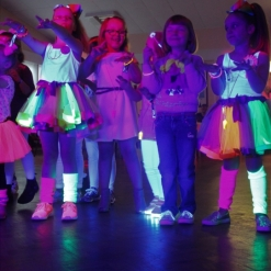 UV GLOW DISCO WITH KIDS IN NEON SOCKS, DRESSES AND LIGHT UP SHOES