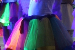 UV GLOW DISCO CLOSE UP OF NEON DRESS GLOWING